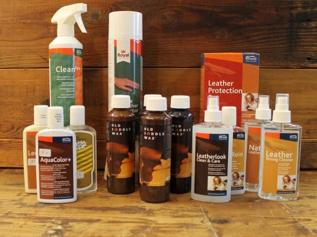 Oranje onderhoudsmiddelen voor leder en stof.